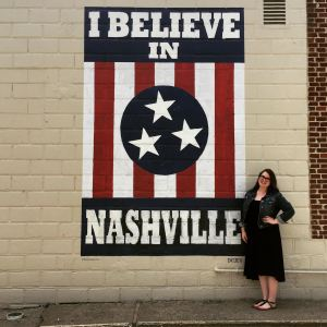 "Lindsey with the ""I Believe in Nashville"" sign."